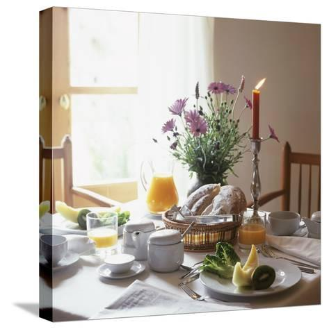 Laid Breakfast Table with Baked Goods, Juice and Fruit--Stretched Canvas Print