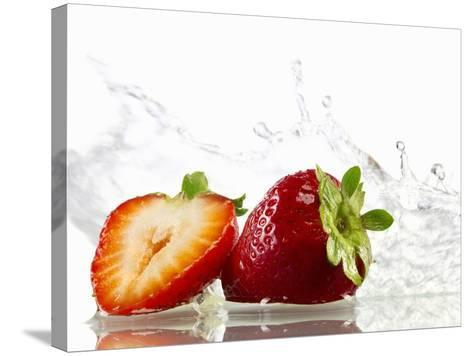Strawberries with Splashing Water-Michael L?ffler-Stretched Canvas Print