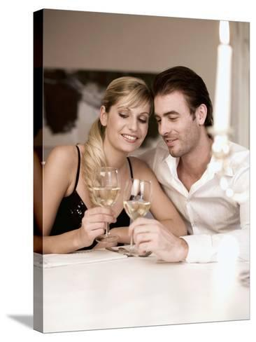 Young Couple Clinking Glasses of White Wine- Sporrer & Skowronek-Stretched Canvas Print