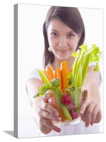 Girl Holding a Bowl of Vegetable Sticks with Radishes--Stretched Canvas Print