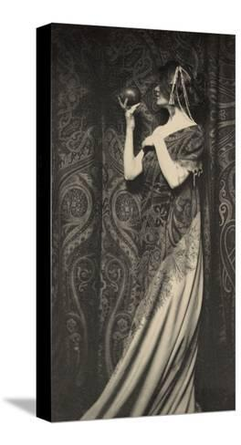Muse Staring at Black Ball--Stretched Canvas Print