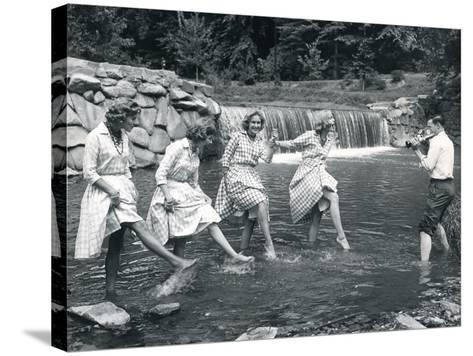 Four Models Kicking Water, 1958--Stretched Canvas Print