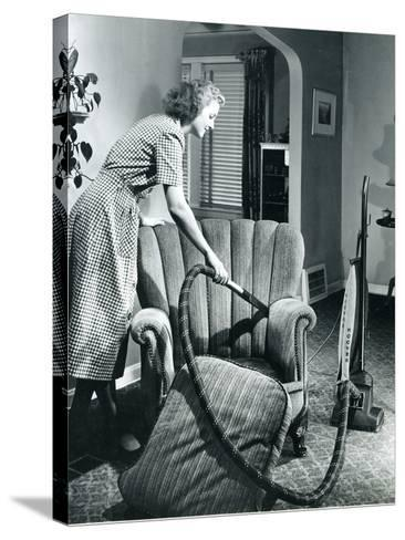 Homemaker Vacuuming, USA, 1950--Stretched Canvas Print