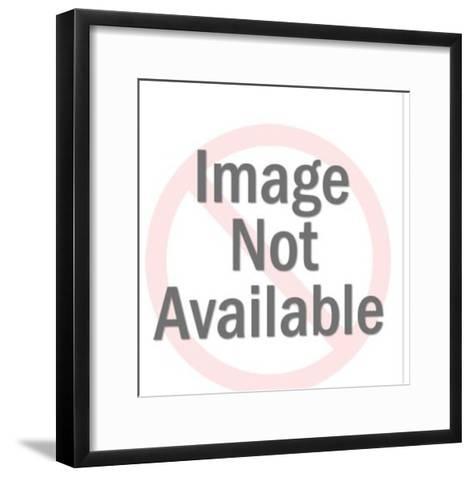 View of Man Walking Way Through Columns-Pop Ink - CSA Images-Framed Art Print