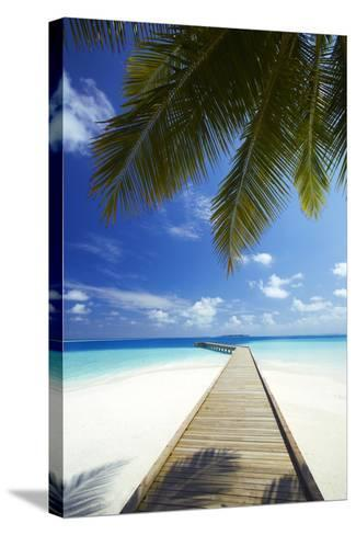 Wooden Jetty Out to Tropical Sea, Maldives, Indian Ocean, Asia-Sakis Papadopoulos-Stretched Canvas Print