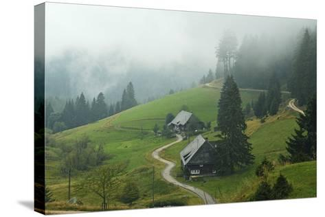 Farmhouses in Fog, Muchenland, Black Forest, Baden-Wurttemberg, Germany, Europe-Jochen Schlenker-Stretched Canvas Print