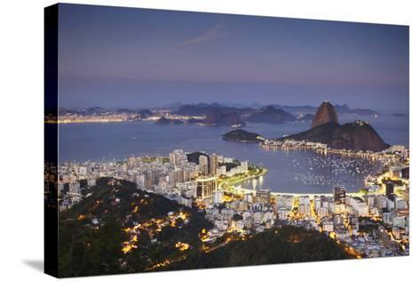 View of Sugar Loaf Mountain (Pao de Acucar) and Botafogo Bay at Dusk, Rio de Janeiro, Brazil-Ian Trower-Stretched Canvas Print