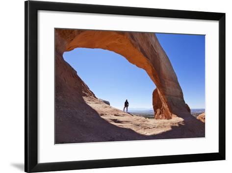 Lone Tourist Hiker at Wilson Arch, Near Moab, Utah, United States of America, North America-Neale Clark-Framed Art Print