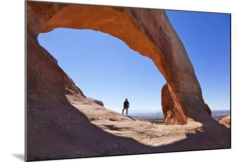 Lone Tourist Hiker at Wilson Arch, Near Moab, Utah, United States of America, North America-Neale Clark-Mounted Photographic Print