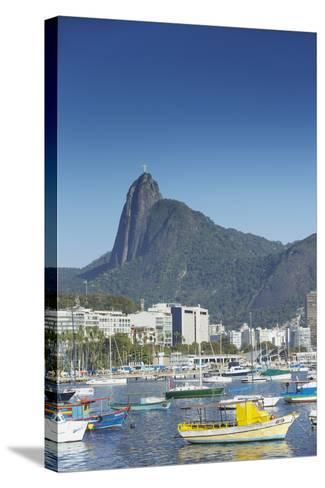 Boats Moored in Harbour with Christ the Redeemer Statue in Background, Urca, Rio de Janeiro, Brazil-Ian Trower-Stretched Canvas Print