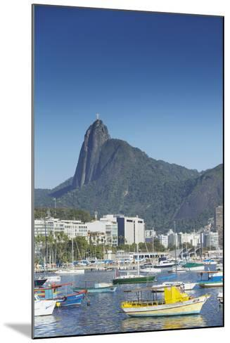 Boats Moored in Harbour with Christ the Redeemer Statue in Background, Urca, Rio de Janeiro, Brazil-Ian Trower-Mounted Photographic Print