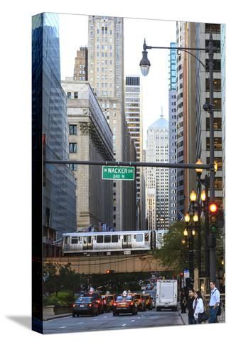 L Train on Elevated Track Crosses South Lasalle Street in the Loop District, Chicago, Illinois, USA-Amanda Hall-Stretched Canvas Print