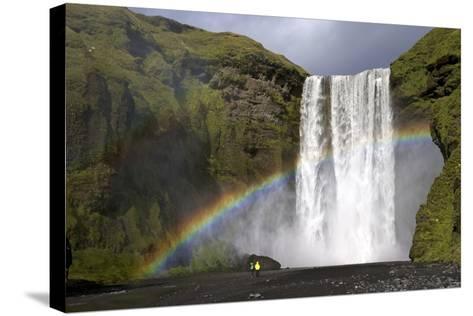 Skogafoss Waterfall with Rainbow in Summer Sunshine, South Coast, Iceland, Polar Regions-Peter Barritt-Stretched Canvas Print