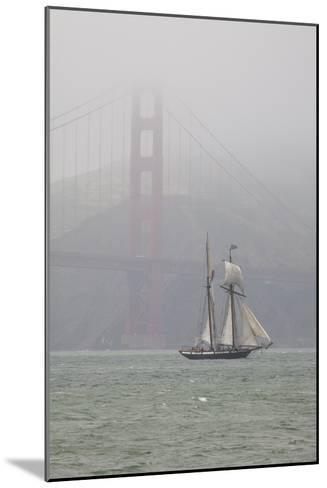 A Two Masted Schooner Sails under the Golden Gate Bridge-Skip Brown-Mounted Photographic Print