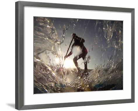 A Stand Up Paddleboarder Surfs a Wave Near Nags Head Pier-Skip Brown-Framed Art Print