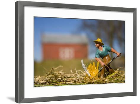 A Lead Figurine of a Farmer Cutting Hay with a Real Barn in Distance-Stephen St^ John-Framed Art Print