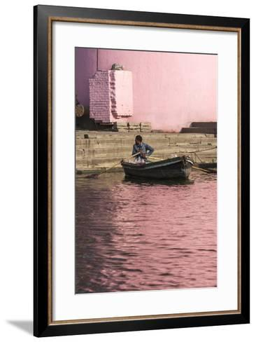 A Man in a Rowboat in Water Tinted Pink by Reflections of a Pink Wall-Jonathan Irish-Framed Art Print