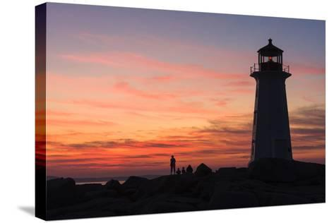 Peggy's Point Lighthouse in Silhouette at Sunset-Jonathan Irish-Stretched Canvas Print