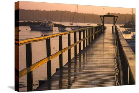 Golden Sunlight on a Pier, Boats, and Water at Sunset-Jonathan Irish-Stretched Canvas Print