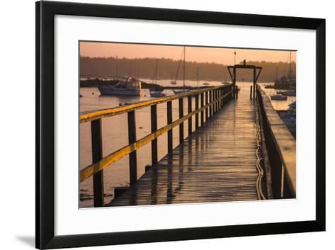 Golden Sunlight on a Pier, Boats, and Water at Sunset-Jonathan Irish-Framed Art Print