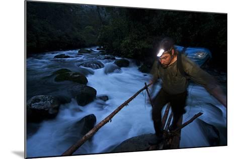 A Birds of Paradise Researcher Walks on a Pole and Vine Bridge-Tim Laman-Mounted Photographic Print