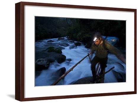 A Birds of Paradise Researcher Walks on a Pole and Vine Bridge-Tim Laman-Framed Art Print