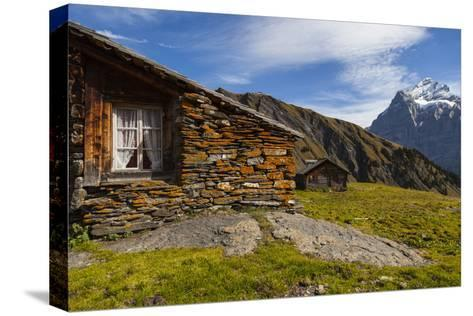 Swiss Alpine Homes Made of Stone Below Jungfrau Mountain-Jonathan Irish-Stretched Canvas Print