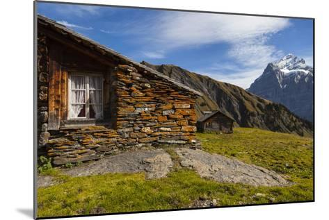 Swiss Alpine Homes Made of Stone Below Jungfrau Mountain-Jonathan Irish-Mounted Photographic Print
