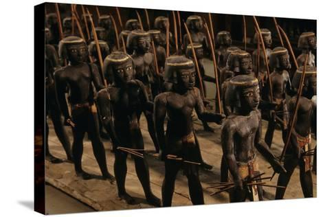 Wooden Nubian Archers from Tomb of Mesehti-Kenneth Garrett-Stretched Canvas Print