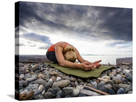 Yoga Position of Child's Pose in Lincoln Park - West Seattle, Washington-Dan Holz-Stretched Canvas Print