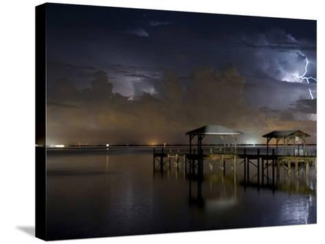 Lightning Off a Dock in Titusville, Florida Looking Towards Cape Canaveral-Melissa Southern-Stretched Canvas Print