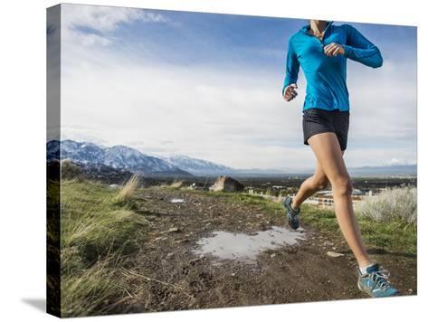 Women Trail Runner, Salt Lake City, Utah,-Brandon Flint-Stretched Canvas Print