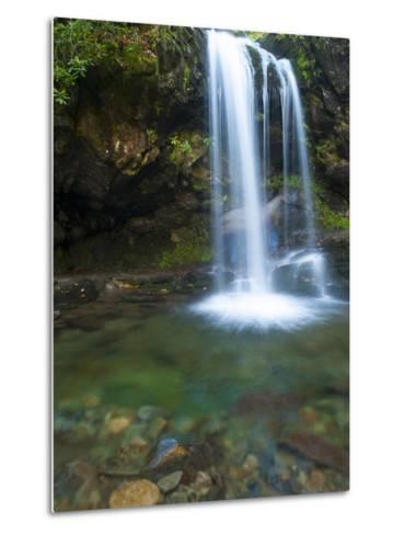Smoky Mountain Natioanl Park: a Hiker Running Behind Grotto Falls-Brad Beck-Metal Print