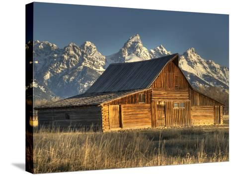 Sunrise at the Mormon Row Barn in Wyoming's Grand Teton National Park-Kyle Hammons-Stretched Canvas Print