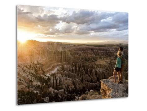 A Couple at Sunset in Bryce Canyon National Park, Utah, in the Summer Overlooking the Canyon-Brandon Flint-Metal Print