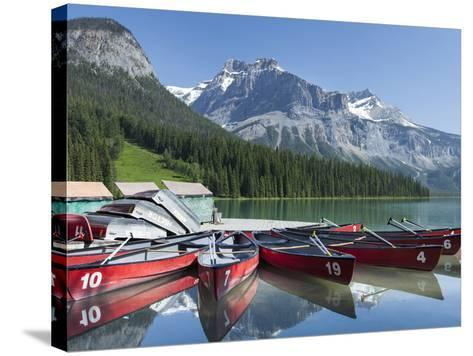 Boat Dock and Canoes for Rent on Emerald Lake, Yoho National Park,British Columbia-Howard Newcomb-Stretched Canvas Print