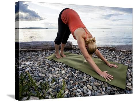 Downward Dog Yoga Pose on the Beach of Lincoln Park - West Seattle, Washington-Dan Holz-Stretched Canvas Print