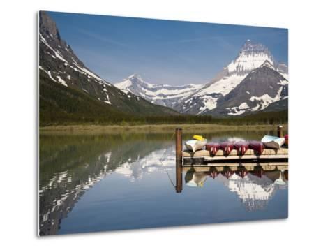 Colorful Canoes Line the Dock at Many Glacier Lodge on Swiftcurrent Lake During Sunrise-Brad Beck-Metal Print