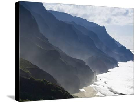The Fluted Ridges of the Na Pali Coast Above the Crashing Surf on the North Shore of Kauai, Hawaii.-Sergio Ballivian-Stretched Canvas Print