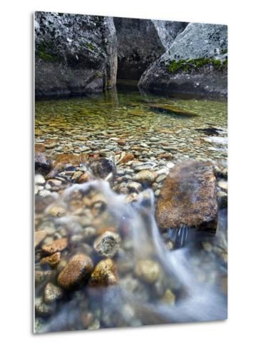 Slow Exposure of Water Flowing Below Vernal Falls with Granite Boulders in the Background.-Ian Shive-Metal Print