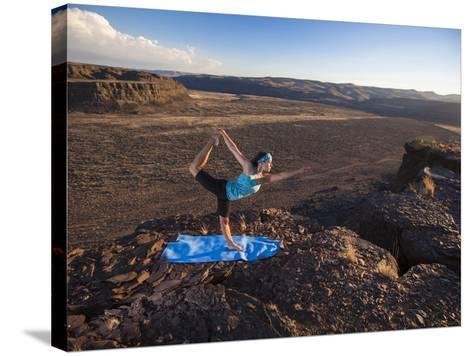 Dancer Pose During an Evening Outdoor Yoga Session at the Frenchman-Coulee in Central Washington.-Ben Herndon-Stretched Canvas Print