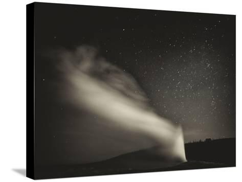 Old Faithful Geyer after Dark at Yellowstone National Park-Rebecca Gaal-Stretched Canvas Print