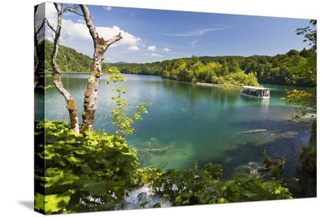 Visitors Taking a Cruise on Lake Kozjak, Plitvice Lakes, Plitvicka Jezera, Croatia-Martin Zwick-Stretched Canvas Print