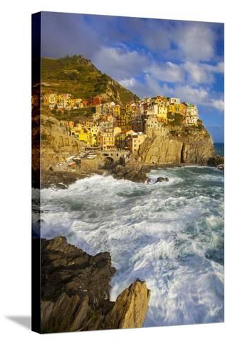 Swirling Ocean at the Foot of Manarola in the Cinque Terre, Liguria Italy-Brian Jannsen-Stretched Canvas Print