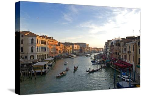 Bustling Riverfront Along the Grand Canal in Venice, Italy-David Noyes-Stretched Canvas Print