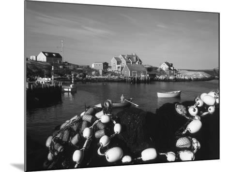 Fishing Nets and Houses at Harbor, Peggy's Cove, Nova Scotia, Canada-Greg Probst-Mounted Photographic Print