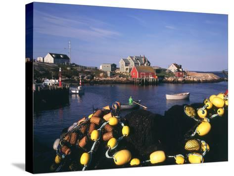 Fishing Nets and Houses at Harbor, Peggy's Cove, Nova Scotia, Canada-Greg Probst-Stretched Canvas Print