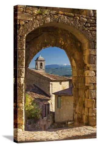 Stone Gate in Lacoste with Mount Ventoux Beyond, Provence, France-Brian Jannsen-Stretched Canvas Print