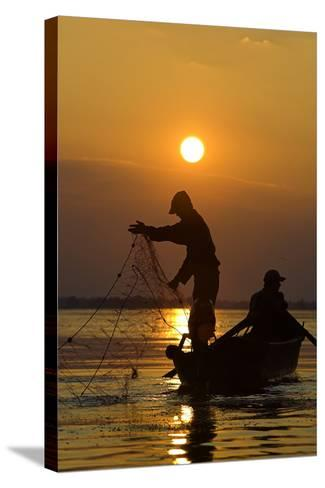Fishing in the Danube Delta, Casting Nets During Sunset on a Lake, Romania-Martin Zwick-Stretched Canvas Print