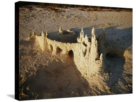 View of Sandcastle on Beach-David Barnes-Stretched Canvas Print